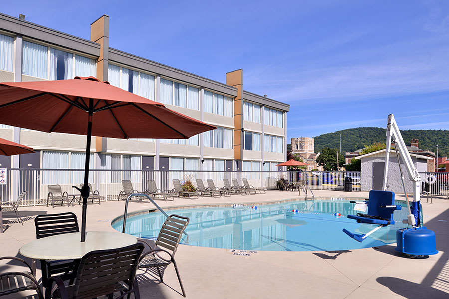 outdoor pool with lift and patio furniture